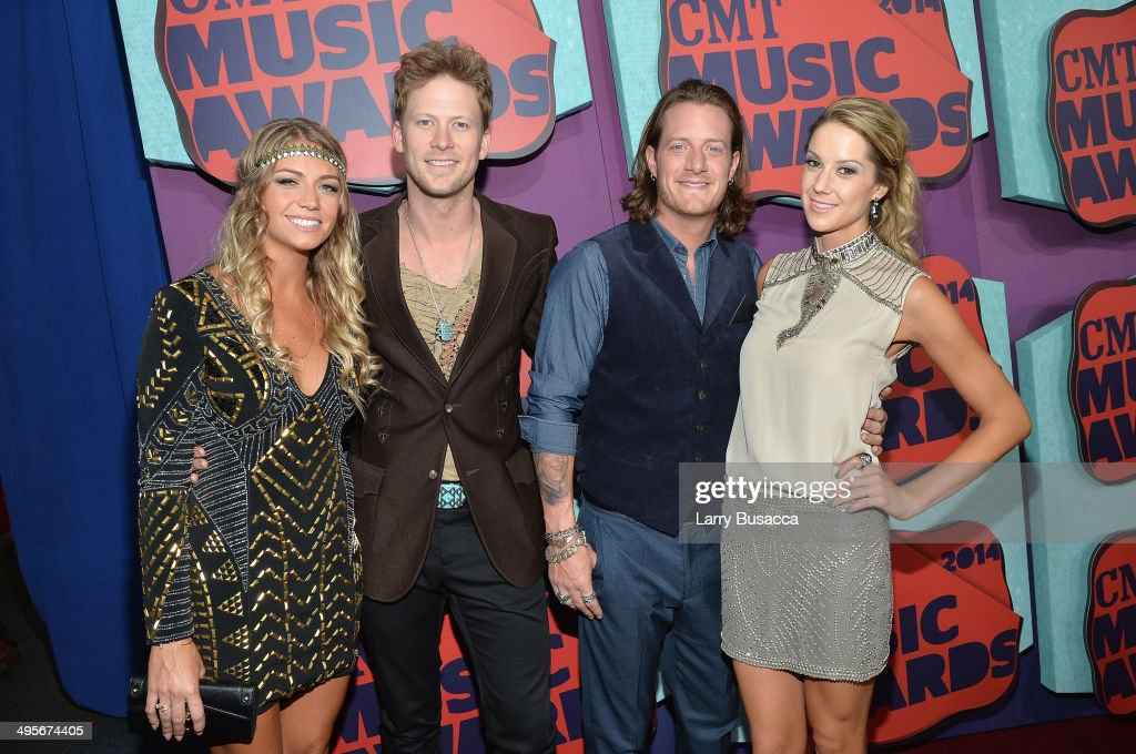 Brittney Marie Cole, Brian Kelley and <a gi-track='captionPersonalityLinkClicked' href=/galleries/search?phrase=Tyler+Hubbard&family=editorial&specificpeople=9453787 ng-click='$event.stopPropagation()'>Tyler Hubbard</a> of Florida Geogria Line and Hayley Stommel attend the 2014 CMT Music awards at the Bridgestone Arena on June 4, 2014 in Nashville, Tennessee.
