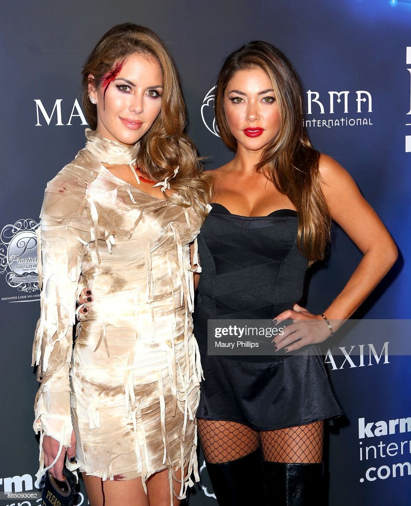 Brittney Palmer and Arianny Celeste arrive at the 2017 Maxim Halloween Party at Los Angeles Center Studios on October 21, 2017 in Los Angeles, California.