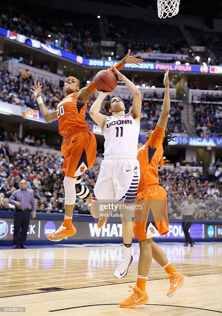 Brittney Sykes and Cornelia Fondren of the Syracuse Orange tries to block a shot by Kia Nurse of the Connecticut Huskies in the second quarter during...