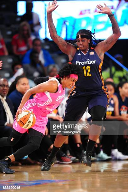 Brittney Sykes of the Atlanta Dream drives to the basket against Lynetta Kizer of the Connecticut Sun during at WNBA game on August 15 2017 at Hank...