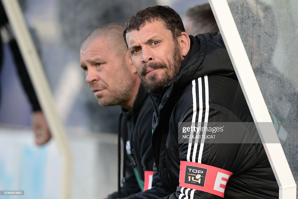 Brive Rugby Union Club's French Head Coach Nicolas Godignon (R) attends the French Top 14 rugby union match between Agen and Brive on April 30, 2016 at the Armandie stadium in Agen, southwestern France.