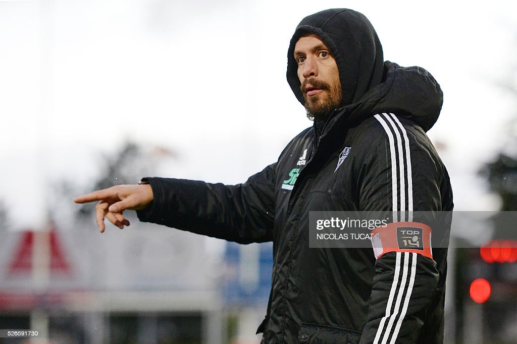 Brive Rugby Union Club's French Head Coach Nicolas Godignon (R) gestures during the French Top 14 rugby union match between Agen and Brive on April 30, 2016 at the Armandie stadium in Agen, southwestern France.