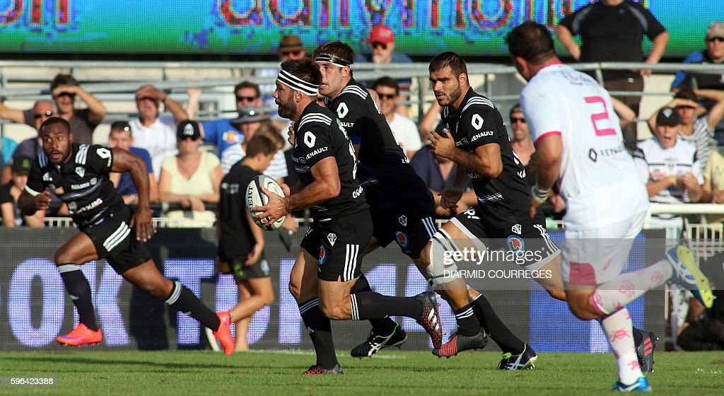 Brive's French centre Arnaud Mignardi runs with the ball during the French Top 14 Rugby union match between Brive and Stade Francais on August 27...