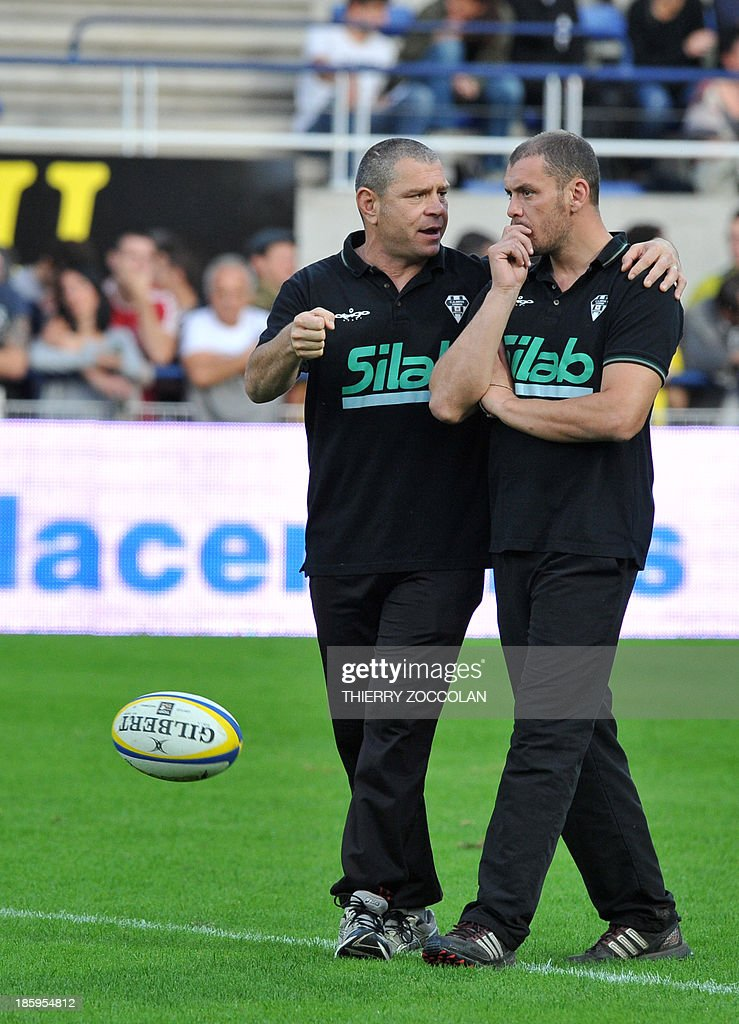 Brive's French coachs Nicolas Godignon (R) and Didier Casadei (L) speak before the French Top 14 rugby Union match between ASM Clermont Auvergne and CA Brive on October 26, 2013 at the Marcel Michelin stadium in Clermont-Ferrand.