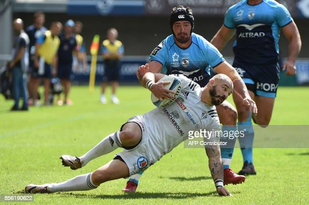 Brive's French fullback Benjamin Lapeyre vies with Montpellier's French Alexandre Dumoulin during the French Top 14 rugby union match between...