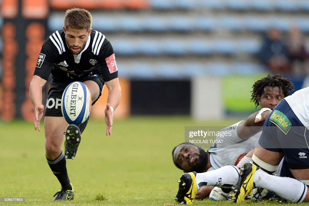 Brive's French scrumhalf Teddy Iribaren (L) runs with the ball during the French Top 14 rugby union match between Agen and Brive on April 30, 2016 at the Armandie stadium in Agen, southwestern France.