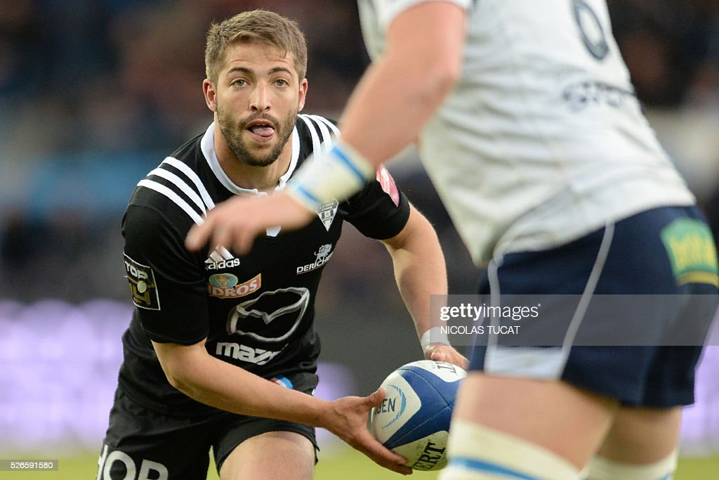 Brive's French scrumhalf Teddy Iribaren runs with the ball during the French Top 14 rugby union match between Agen and Brive on April 30, 2016 at the Armandie stadium in Agen, southwestern France.