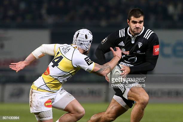 Brive's fullback Gaetan Germain runs with the ball during the French Top 14 rugby union match between Brive and La Rochelle at Amedee Domenech...