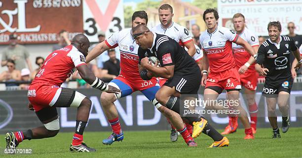 Brive's number eight Sisaro Koyamaibole runs with the ball during the French Top 14 rugby union match C A Brive versus Grenoble on may 21 2016 at the...