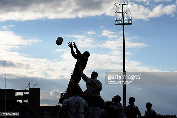 A Brive's player catches the ball in a line up during the French Top 14 rugby union match between Agen and Brive on April 30 2016 at the Armandie...