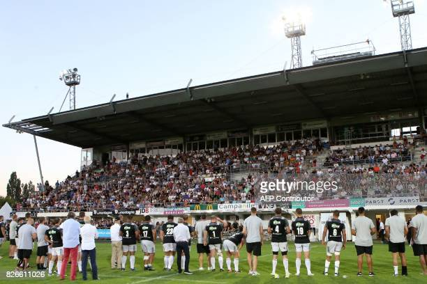 Brive's players and staff members greet the audience during the team's official presentation ahead of the start of the French Top14 rugby union...