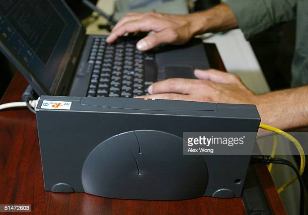Broadband Over Power Line modem is sits next to a laptop during a tour to view the technologies October 12 2004 in Manassas Virginia BPL technology...
