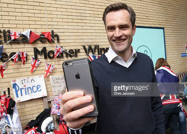 Broadcast Journalist Max Foster of CNN uses Periscope as he describes the scenes at the Lindo wing as the World's media wait for Catherine Duchess of...