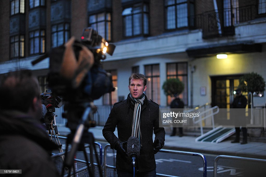 A broadcast journalist works outside the King Edward VII hospital in central London on December 7, 2012 after nurse Jacintha Saldanha was found dead at a property close by. A nurse at the hospital which treated Prince William's pregnant wife Catherine, Duchess of Cambridge, was found dead on December 7, days after being duped by a hoax call from an Australian radio station, the hospital said. Police said they were treating the death, which happened at a property near the hospital, as unexplained. AFP PHOTO / CARL COURT