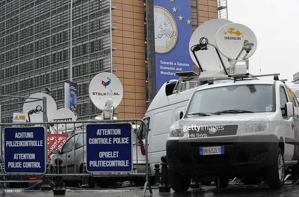 Broadcast trucks are parked near the EU Headquarters on November 23, 2012 in Brussels, during a two-day European Union leaders summit called to agree a hotly-contested trillion-euro budget through 2020. European leaders voiced pessimism on reaching a deal on a trillion-euro EU bdget, as gruelling talks pushed into a second day with little prospect of bridging bitter divisions. AFP PHOTO / JOHN THYS