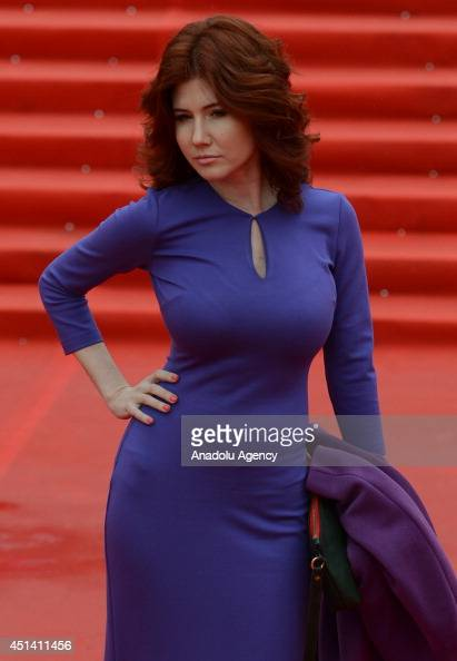 Broadcaster Anna Chapmanposes on the red carpet during the closing ceremony of the 36th Moscow International Film Festival in Moscow Russia on June...
