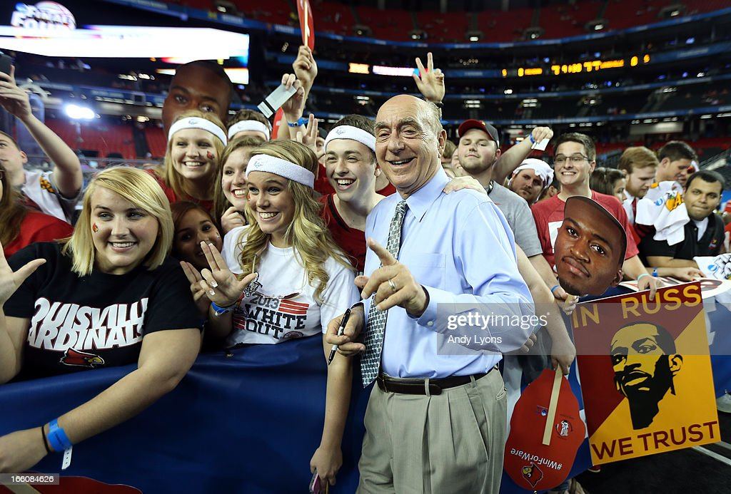 ESPN broadcaster <a gi-track='captionPersonalityLinkClicked' href=/galleries/search?phrase=Dick+Vitale&family=editorial&specificpeople=730924 ng-click='$event.stopPropagation()'>Dick Vitale</a> poses with fans before the 2013 NCAA Men's Final Four Championship between the Michigan Wolverines and the Louisville Cardinals at the Georgia Dome on April 8, 2013 in Atlanta, Georgia.