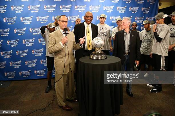TNT broadcaster Ernie Johnson presents Peter Holt owner of the San Antonio Spurs with the Western Conference Champions Trophy after Game 6 of the...