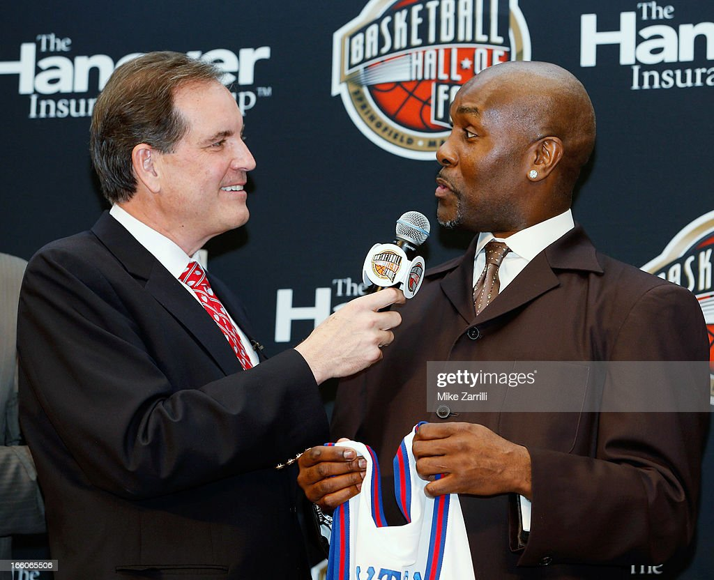 CBS broadcaster Jim Nance talks to former NBA player <a gi-track='captionPersonalityLinkClicked' href=/galleries/search?phrase=Gary+Payton&family=editorial&specificpeople=201500 ng-click='$event.stopPropagation()'>Gary Payton</a> during the Naismith Memorial Basketball Hall of Fame announcement ceremony at Marriott Marquis on April 8, 2013 in Atlanta, Georgia.
