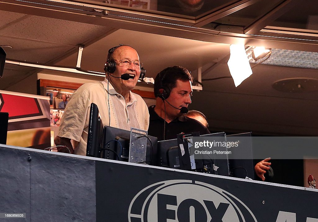 Broadcaster Joe Garagiola (L) reacts in honor of his retirement, standing with Steve Berthiaume during the MLB game between the Arizona Diamondbacks and the Los Angeles Dodgers at Chase Field on April 14, 2013 in Phoenix, Arizona.