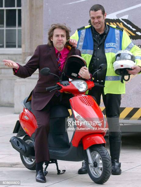 Broadcaster Jonathan Ross and police rider Fredd Moffett during a photocall to launch the City of London ScooterSafe Initiative a road awareness...
