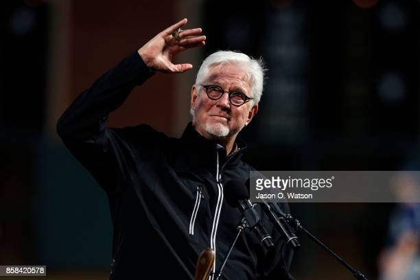 Broadcaster Mike Krukow of the San Francisco Giants stands on the field during the 2017 Willie Mac Award ceremony before the game against the San...