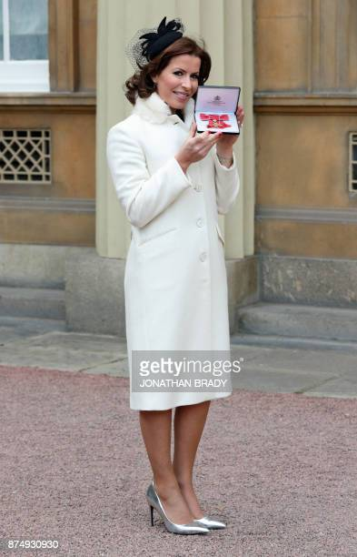 Broadcaster Natasha Kaplinsky poses with her award after she was appointed OBE by the Prince of Wales during an Investiture ceremony at Buckingham...