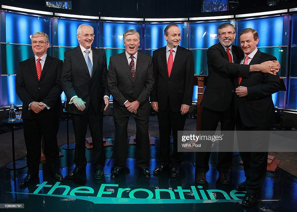 Broadcaster Pat Kenny (3rd L) laughs as Sinn Fein's <a gi-track='captionPersonalityLinkClicked' href=/galleries/search?phrase=Gerry+Adams&family=editorial&specificpeople=203162 ng-click='$event.stopPropagation()'>Gerry Adams</a> hugs <a gi-track='captionPersonalityLinkClicked' href=/galleries/search?phrase=Enda+Kenny&family=editorial&specificpeople=5129605 ng-click='$event.stopPropagation()'>Enda Kenny</a> of Fine Gael as Eamon Gilmore of Labour (L), John Gormley of the Green Party (2nd L) and Fianna Fail's Michael Martin look on at the first televised debate with all the five main party leaders, in RTE Studios, on February 14, 2011 in Dublin, Ireland. The 90 minute debate comes ahead of the February 25 election where Irish voters will go to the polls to choose a new Government.