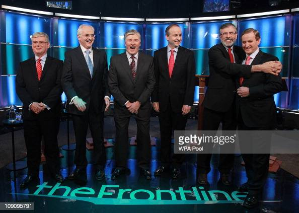 Broadcaster Pat Kenny laughs as Sinn Fein's Gerry Adams hugs Enda Kenny of Fine Gael as Eamon Gilmore of Labour John Gormley of the Green Party and...