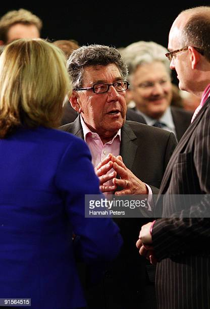 Broadcaster Paul Holmes talks with Police Minister Judith Collins and Health Minister Tony Ryall after listening to New Zealand Prime Mininster John...
