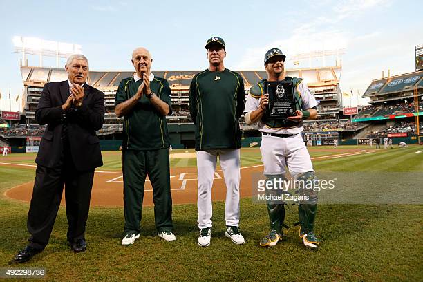 Broadcaster Ray Fosse Equipment Manager Steve Vucinich and Manager Bob Melvin of the Oakland Athletics present Stephen Vogt with the Catfish Hunter...