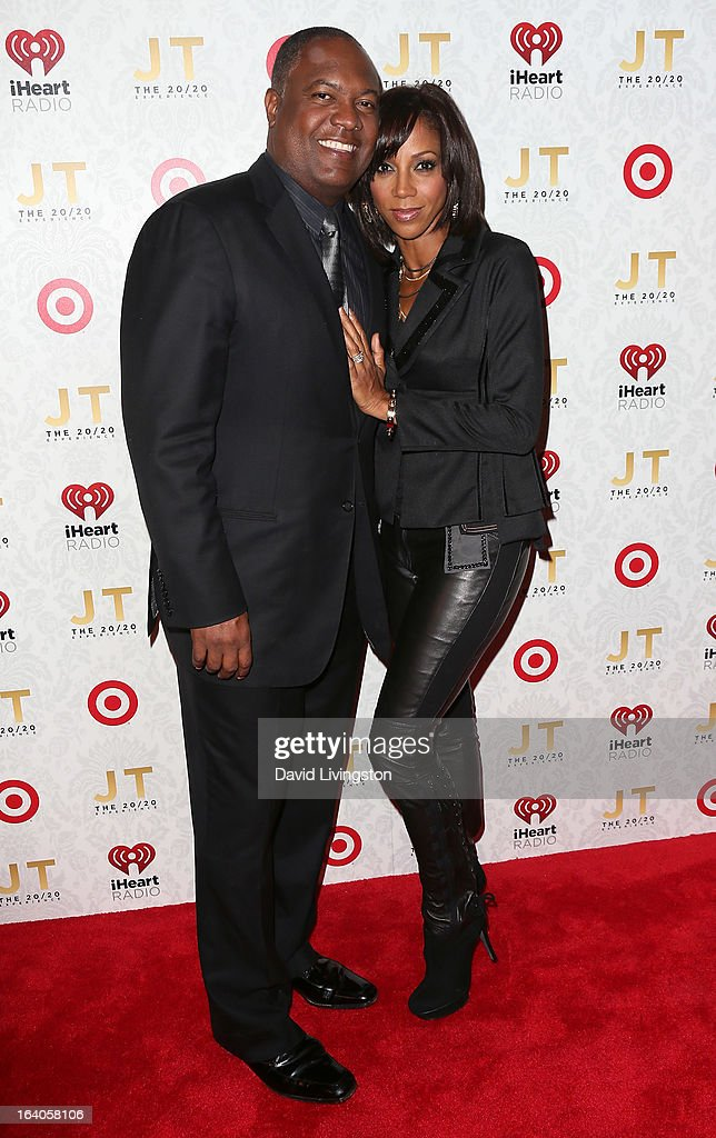 Broadcaster Rodney Peete (L) and wife actress Holly Robinson Peete attend the iHeartRadio '20/20' album release party with Justin Timberlake presented by Target at the El Rey Theatre on March 18, 2013 in Los Angeles, California.
