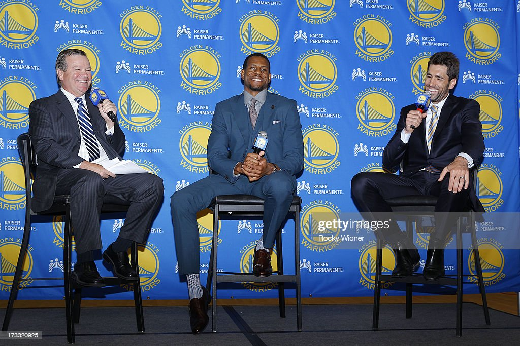 Broadcaster Tim Roye, Andre Iguodala #9 of the Golden State Warriors and General Manager Tim Roye share a laugh at a press conference on July 11, 2013 in Oakland, California.