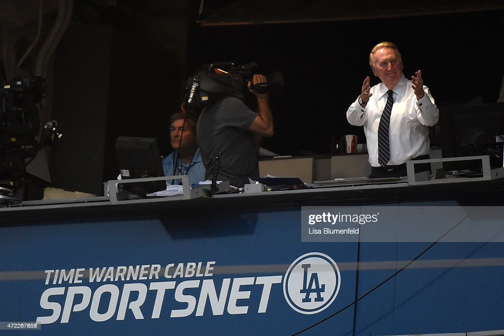Broadcaster Vin Scully acknowledges the crowd as the Colorado Rockies take on the Los Angeles Dodgers at Dodger Stadium on April 18 2015 in Los...