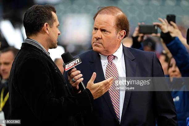 Broadcasters Aaron Boone and Chris Berman of ESPN are seen on the field before Game One of the 2016 World Series between the Chicago Cubs and the...