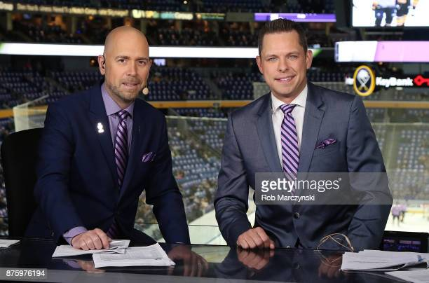 Broadcasters Brian Duff and Martin Biron wear special ties on Hockey Fights Cancer Night before an NHL game between the Buffalo Sabres and the...