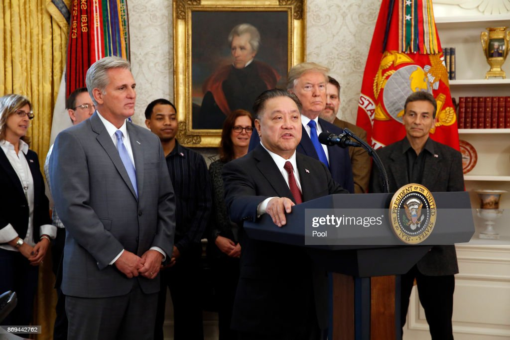 Broadcom CEO Hock Tan announces the repatriation of his company headquarters to the United States from Singapore as U.S. President Donald Trump looks on during a ceremony in the Oval Office of the White House on November 2, 2017 in Washington, DC. At left is Rep. Kevin McCarthy (R-CA).