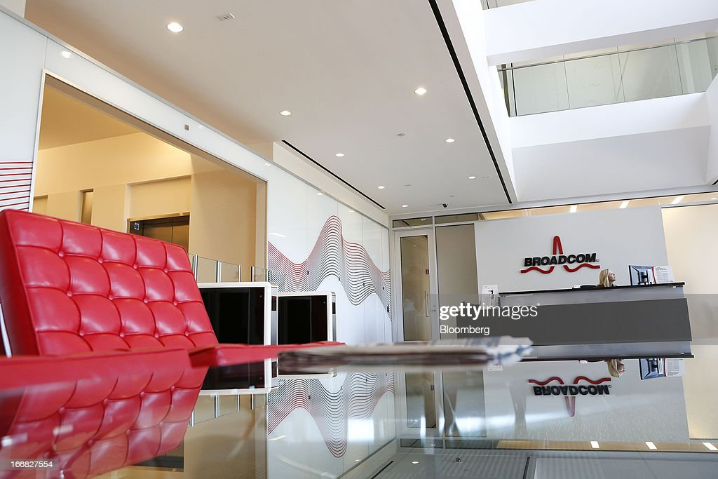 Broadcom Corp. signage is displayed in the lobby of the company's headquarters in Irvine, California, U.S., on Friday, April 12, 2013. Broadcom Corp. designs, develops, and supplies integrated circuits for cable set-top boxes, cable modems, high-speed networking, direct satellite and digital broadcast, and digital subscriber line. Photographer: Patrick Fallon/Bloomberg via Getty Images