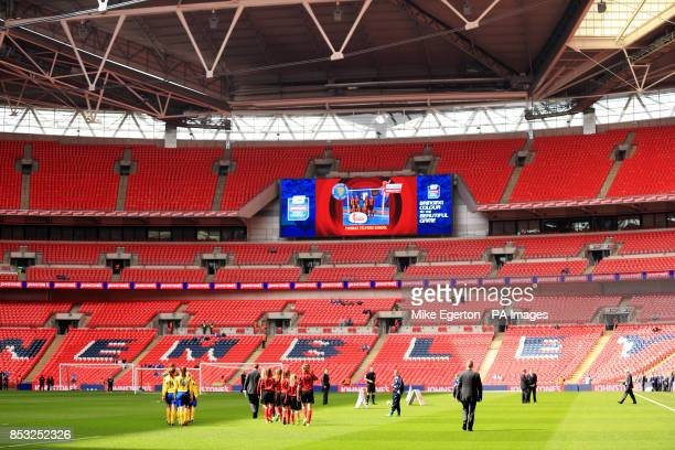 Broadstone Middle School and Thomas Telford School walk out at Wembley for the Girl's Cup Final