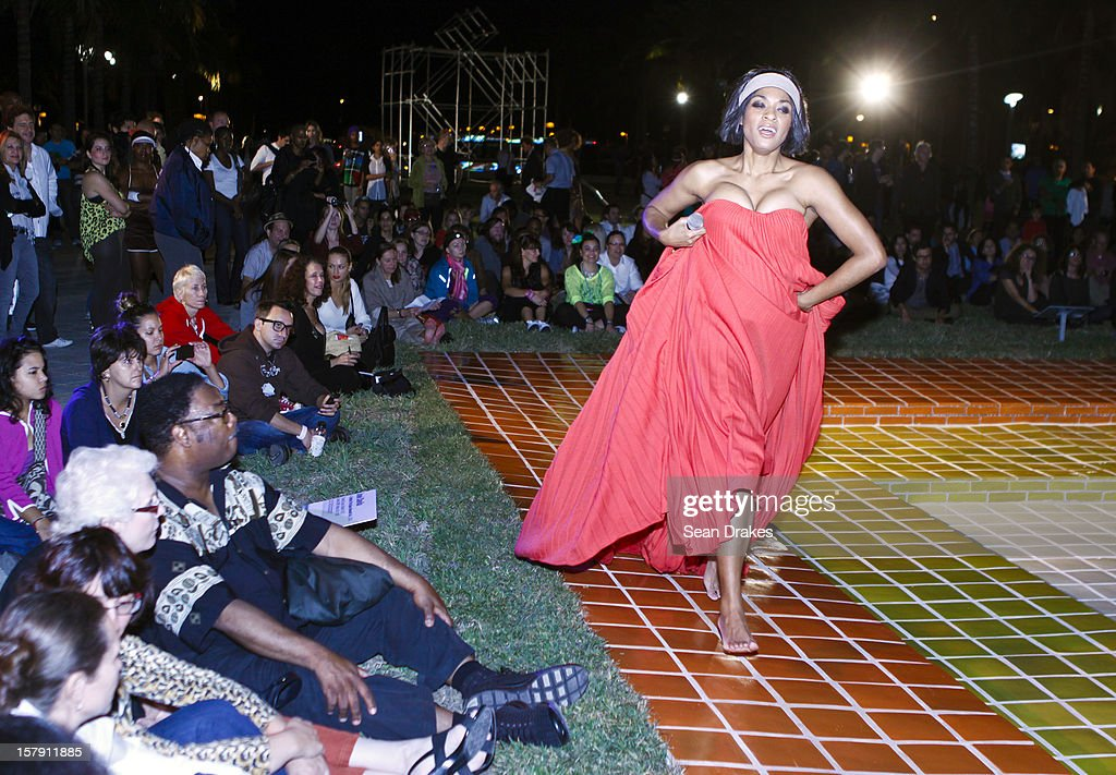 Broadway actress Alicia Hall Moran performs a top a tile installation titled 'The Space Beneath Us' by Jose Davila at the at Art Basel Miami on December 5, 2012 in Miami Beach, Florida.