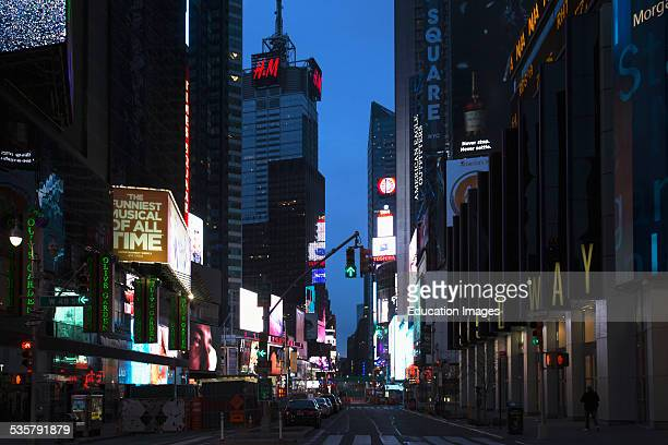 Broadway at dusk shows neon lights New York