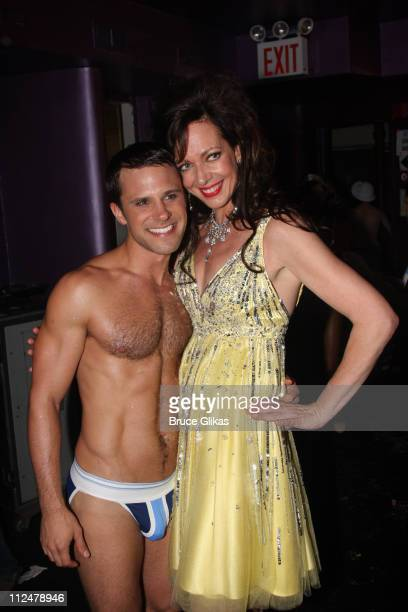 A Broadway Bares dancer and Allison Janney pose at 'BROADWDAY BARES 190 CLICK IT'on Broadway at Roseland on June 21 2009 in New York City