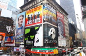 Broadway movie posters in Times Square in New York New York on AUG 04 2011
