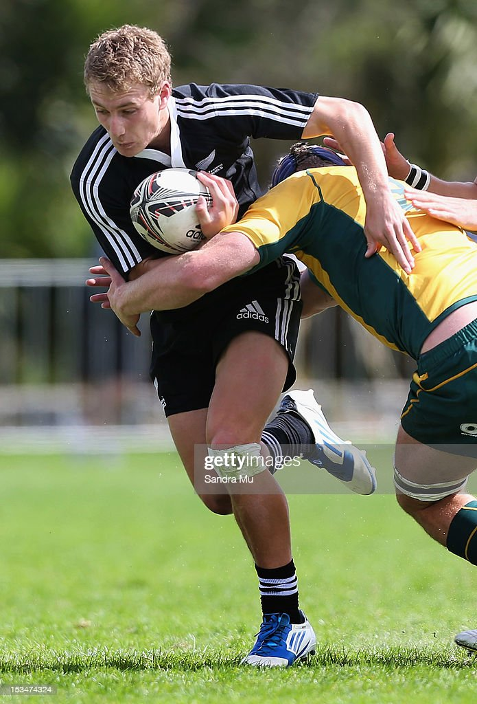 Broc Hooper of New Zealand is tackled during the Test between New Zealand Schools and Australia Schools at Auckland Grammar on October 6, 2012 in Auckland, New Zealand.