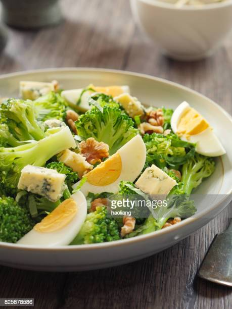 Broccoli and eggs salad with blue cheese and walnuts
