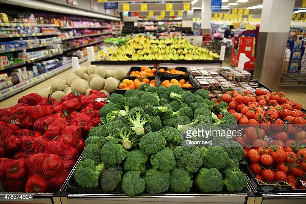 Broccoli and other vegetables sit on display for sale at an Aldi Stores Ltd food store in Sydney Australia on Thursday June 25 2015 Australia's...