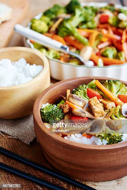 Broccoli, carrot, mushroom stir fry with tofu on rice