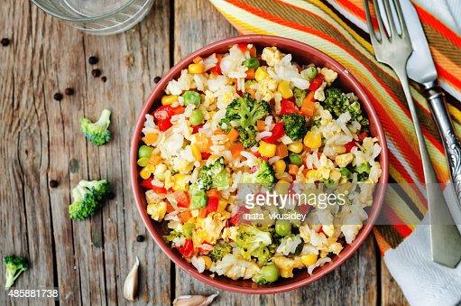 broccoli carrots corn green peas red pepper rice : Stock Photo