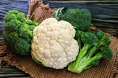 Broccoli, cauliflower and cabbage on a rustic background
