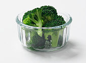 Broccoli in a glass bowl, studio shot